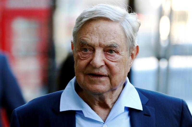 George Soros, Mastercard to partner to aid migrants, refugees