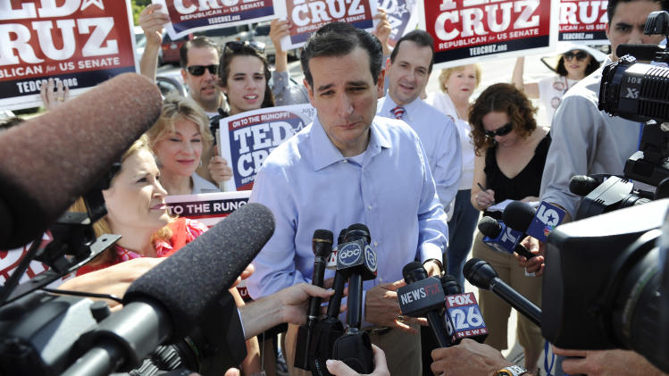 Former Texas Solicitor General Ted Cruz, center, is surrounded by supporters and media at a voting precinct Tuesday, July 31, 2012, in Houston. Cruz faces Lt. Gov. David Dewhurst in the Republican primary runoff election for the Republican nomination for the U.S. Senate. (AP Photo/Pat Sullivan)