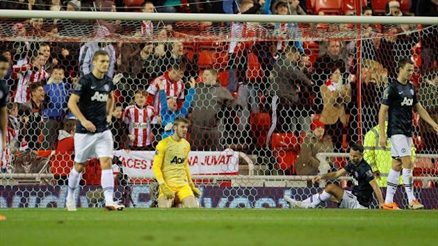 Manchester United's David De Gea, centre looks on after Phil Bardsley scores Sunderland's opening goal during the Capital One Cup - Semi Final - First Leg - Sunderland v Manchester United - Stadium of Light