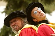 In this Wednesday, May 12, 2004, file photo, Barry Gibb, left, and Robin Gibb, right, clown around as they pose for pictures after receiving honorary degrees from the University of Manchester, in Manchester, England, Wednesday May 12, 2004. A representative said on Sunday, May 20, 2012, that Robin Gibb died at the age of 62. (AP Photo/Jon Super)