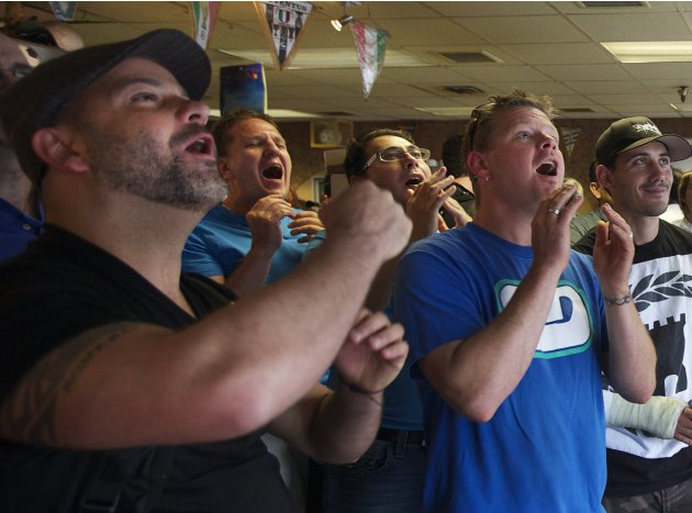 Soccer fans react while watching the Euro 2012 semi-final between Italy and Germany in Vancouver