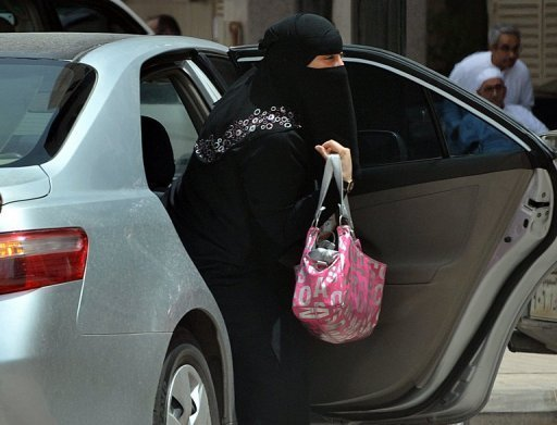 A Saudi woman gets out of a car in Riyadh. Activists have urged women to get behind the wheel for Sunday's first anniversary of the Women2Drive campaign, which resulted in the arrest of people defying Saudi Arabia's ban on women drivers