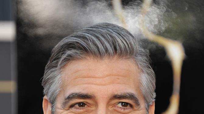 Actor George Clooney arrives at the Oscars at the Dolby Theatre on Sunday Feb. 24, 2013, in Los Angeles. (Photo by John Shearer/Invision/AP)