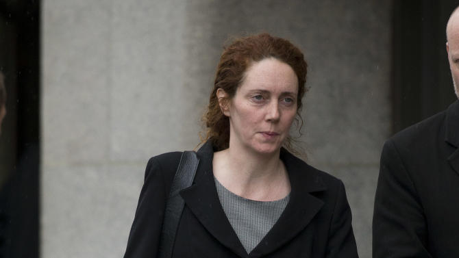 Rebekah Brooks, the former chief of News Corp.'s British newspapers leaves after attending a hearing in a corruption case at the Old Bailey court in the City of London, Friday, March 8, 2013.  Brooks appeared in court Friday to face charges over alleged conspiracy to bribe a public official to obtain information.  (AP Photo/Matt Dunham)