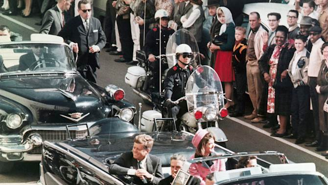 FILE - In this Nov. 22, 1963 file photo, President John F. Kennedy's motorcade travels through Dallas. (AP Photo/PRNewsFoto/Newseum, File) THIS CONTENT IS PROVIDED BY PRNewsfoto and is for EDITORIAL USE ONLY