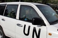 Members of a UN monitoring team, tasked with monitoring the UN-backed ceasefire in Syria, arrive at a hotel in Damascus. Syria sought on Wednesday to reassure the United Nations over its willingness to implement a ceasefire despite violence and casualties still reported in various parts of the country