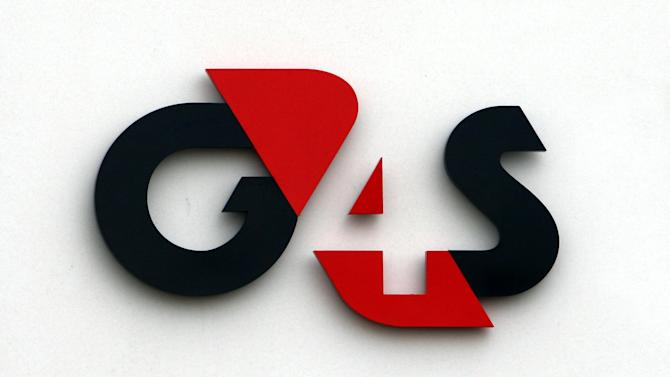 FILE This is a April 24, 2012 file photo of the G4S logo. The British government said Thursday July 11. 2013 it was calling in fraud investigators after auditors found security giant G4S had overcharged by millions of pounds on contracts to monitor offenders using electronic tags. (AP Photo/David Jones/PA) UNITED KINGDOM OUT
