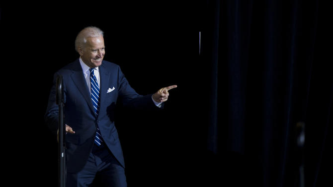 Vice President Joe Biden takes the stage for a news conference, Thursday, Feb. 6, 2014, at 30th Street Station in Philadelphia. Biden in his visit to the train station stressed the need for infrastructure investment (AP Photo/Matt Rourke)