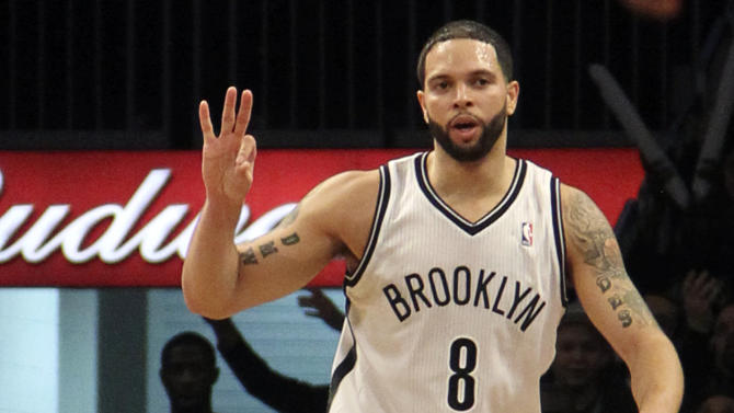 Brooklyn Nets' Deron Williams gestures after scoring a 3-point basket during the first half of NBA basketball game against the Washington Wizards, Friday, March 8, 2013, in New York. (AP Photo/Mary Altaffer)