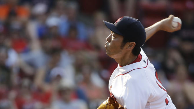 Boston Red Sox relief pitcher Koji Uehara winds up for a pitch in the ninth inning of a baseball game against the Houston Astros at Fenway Park, Sunday, July 5, 2015, in Boston. The Red Sox won 5-4. (AP Photo/Steven Senne)