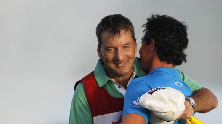 Rory McIlroy of Northern Ireland, right, is hugged by his caddie JP Fitzgerald after winning the Honda Classic golf tournament  with a 12-under-par 268 in Palm Beach Gardens, Fla., Sunday, March 4, 2012. McIlroy is now the number-one ranked player in the world. (AP Photo/Lynne Sladky)