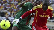 Uganda's goalkeeper Denis Onyango shields the ball from Zambia's Christopher Katongo during their African Cup of Nations qualification match (Reuters)