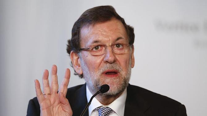 Spanish Prime Minister Mariano Rajoy gestures during a meeting at Villa Madama in Rome