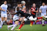 Castres&#39; scrum half Rory Kockott is tackled by Toulouse&#39;s winger Timoci Matanavu (C) during a Top 14 rugby match in Toulouse&#39;s stadium. Former champions Toulouse secured their place in the final of the French Top 14 championship with a 24-15 semi-final win over Castres