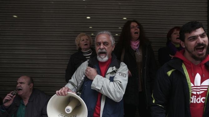 Protesters shout slogans during a rally outside the Health Ministry in Athens