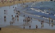 File picture. People gather at the beach in Cadiz, Spain. Europe is largely a place for retirement in the sun, in France and Spain, although Britain and India came top as ideal choices for retirement, a recent survey shows