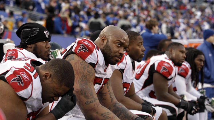 Atlanta Falcons defensive end John Abraham, third left, sits on the bench with his teammates during the second half of an NFL wild card playoff football game against the New York Giants Sunday, Jan. 8, 2012, in East Rutherford, N.J. The Falcons lost the game 24-2.  (AP Photo/Matt Slocum)