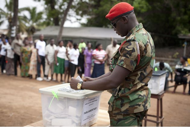 A soldier casts his votes in parliamentary and presidential elections, at an outdoor polling station in Accra, Ghana, Friday, Dec. 7, 2012. Ghanaians went to the polls Friday to choose between four ca