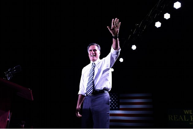 Republican presidential candidate, former Massachusetts Gov. Mitt Romney takes the stage at an election campaign rally at the Reno Event Center in Reno, Nev., Wednesday, Oct. 24, 2012. (AP Photo/Charl