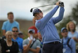 Tom Watson of the U.S. watches his tee shot on the second hole during the first round of the British Open golf Championship at Muirfield in Scotland