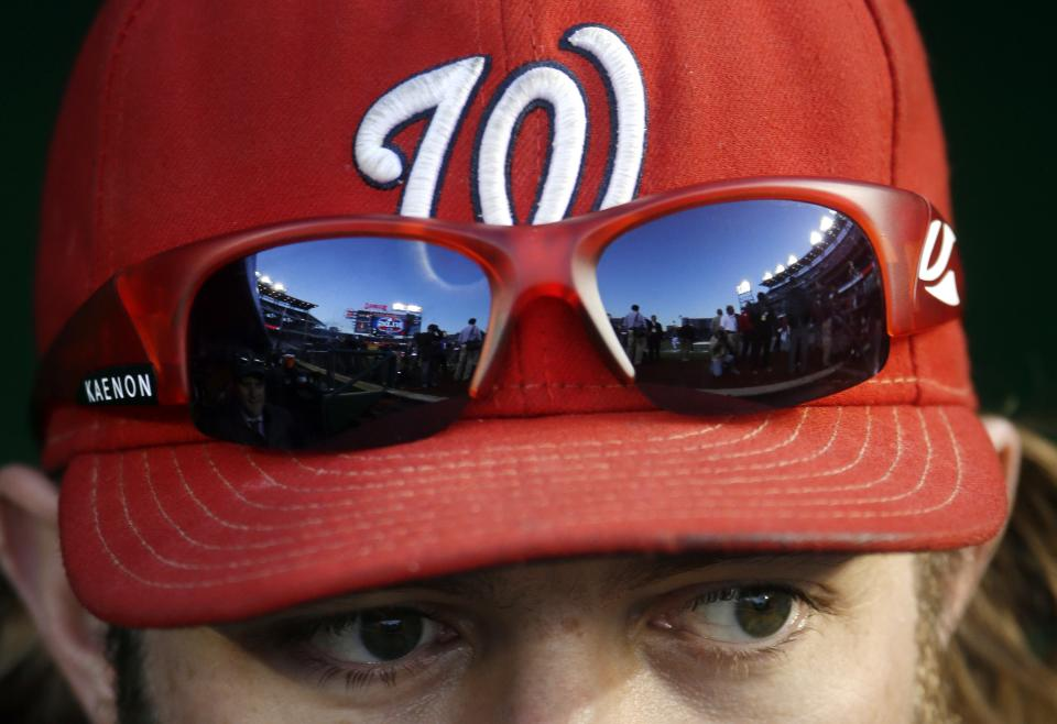 Nationals Park is reflected in the sunglasses of Washington Nationals' Jayson Werth before Game 5 of the team's National League division baseball series against the St. Louis Cardinals on Friday, Oct. 12, 2012, in Washington. (AP Photo/Pablo Martinez Monsivais)