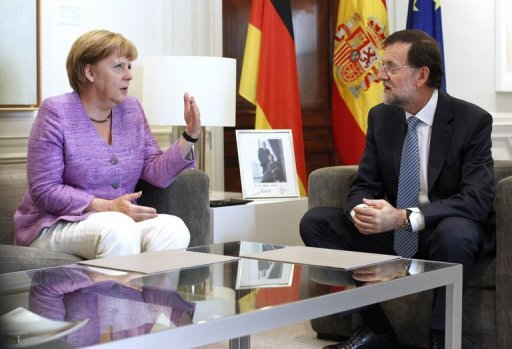 "<p>Spanish Prime Minister Mariano Rajoy (right) talks with German Chancellor Angela Merkel during a meeting at the Moncloa palace in Madrid on September 6. Spain and Germany will do what it takes to resolve the eurozone debt crisis, Rajoy said Thursday after the talks. ""We want to dispel any doubts on the markets about the continuity of the euro,"" he said in a joint news conference in Madrid.</p>"