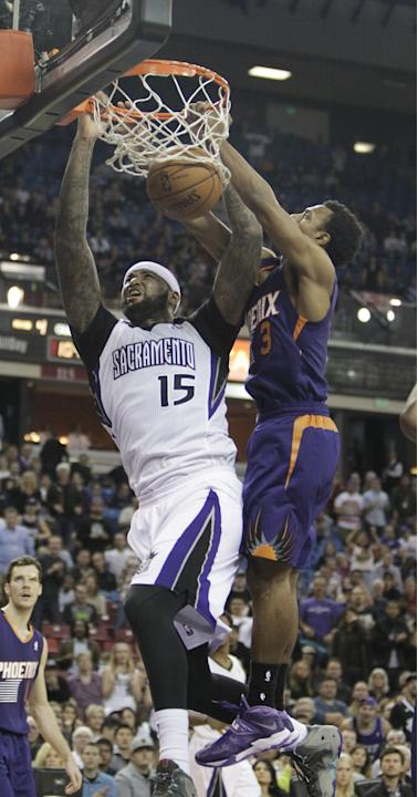 Sacramento Kings center DeMarcus Cousins, left, stuffs against Phoenix Suns guard Ish Smith during the fourth quarter of an NBA basketball game in Sacramento, Calif., Tuesday, Nov. 19, 2013.  The King