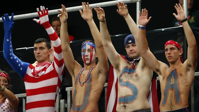 Fans of the U.S. team cheer before their Women's preliminary round group A basketball match against Turkey at the Basketball Arena during the London 2012 Olympic Games