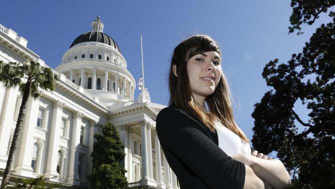 Eli Erlick, 17, stands outside the Capitol building in Sacramento, Calif., on Wednesday, April 17, 2013 after testifying before an education committee. Erlick is the director of an organization called Trans Student Equality Resources, which provides schools with training and information about students like her. Among other things, the group explains gender differences and how students transition, including name and pronoun changes. Erlick also has helped her school district and others in California develop transgender policies. (AP Photo/Rich Pedroncelli)