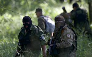 Pro-Russian insurgents with weapons arrive near the …