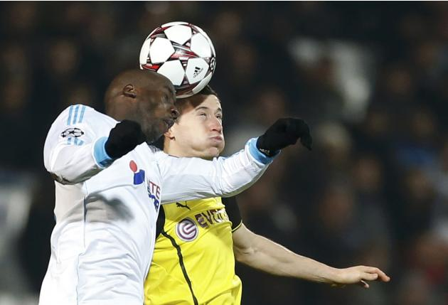 Olympique Marseille's Diawara challenges Borussia Dortmund's Lewandowski during their Champions League soccer match in Marseille