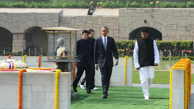 U.S. President Barack Obama walks at the site where Indian independence icon Mahatma Gandhi was cremated in New Delhi, India, Sunday, Jan. 25, 2015. Obama's arrival Sunday morning in the bustling capital of New Delhi marked the first time an American leader has visited India twice during his presidency. Obama is also the first to be invited to attend India's Republic Day festivities, which commence Monday and mark the anniversary of the enactment of the country's democratic constitution. (AP Photo)