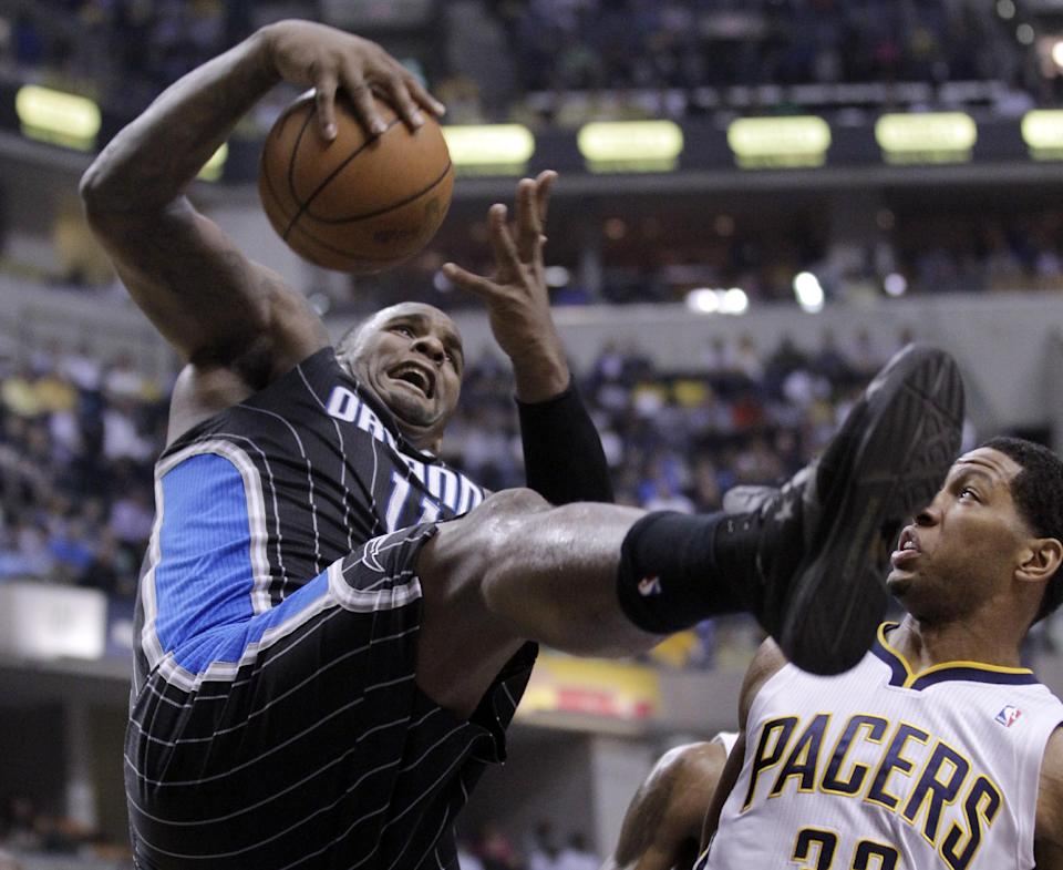 Orlando Magic forward Glen Davis, left, grabs a rebound in front of Indiana Pacers forward Danny Granger during the first half of the second game of an NBA first-round playoff basketball series, in Indianapolis, Monday, April 30, 2012. (AP Photo/Michael Conroy)