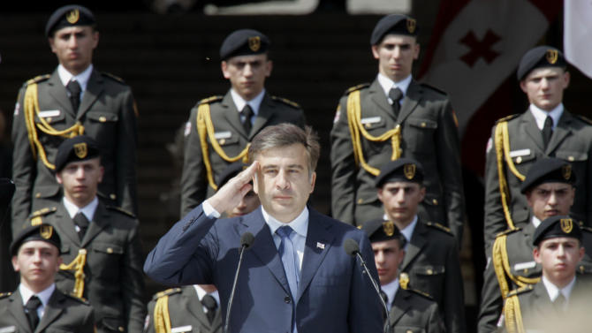 Georgian President Mikhail Saakashvili salutes during a military parade marking Georgia's Independence Day, in Tbilisi, Georgia, Thursday, May 26, 2011. Georgian officials said Thursday a police officer and a demonstrator were killed during the violent clearing of an anti-government protest in the capital Tbilisi. The demonstration was designed to impede an Independence Day military parade, which began on the capital city's central avenue without any signs of the chaos that blemished it overnight. (AP Photo/Shakh Aivazov)