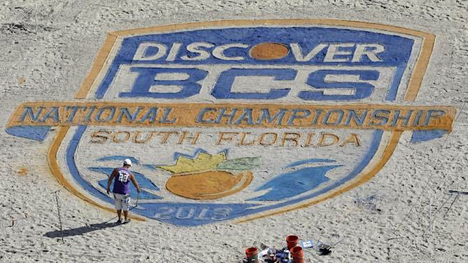An artist puts the finishing touches on the BCS National Championship logo on the beach Sunday, Jan. 6, 2013, in Fort Lauderdale, Fla. Notre Dame takes on Alabama for the National Championship in an NCAA college football game on Monday night. (AP Photo/Chris O'Meara)