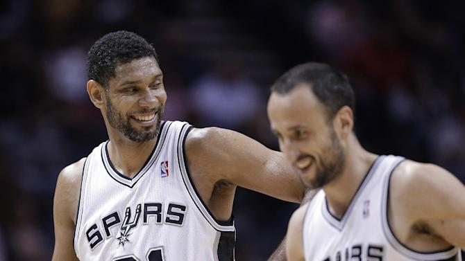 San Antonio Spurs' Tim Duncan (21) celebrates with Manu Ginobili (20) during the second half of an NBA basketball game against the Denver Nuggets, Wednesday, March 26, 2014, in San Antonio. San Antonio won 108-103