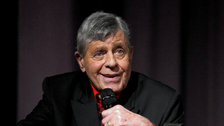 "FILE - In this Dec. 7, 2011 file photo released by Starz shows comedian Jerry Lewis speaking at the Encore Original premiere of ""Method to the Madness of Jerry Lewis"" in Los Angeles. The 86-year-old Lewis was hospitalized Tuesday, June 12, just before he was scheduled to receive an award and present another to Tom Cruise at the Friars Club Entertainment Icon Awards in New York. Publicist Candi Cazau says he should be released from the hospital sometime Wednesday. (AP Photo/Starz, Joe Kohen)"