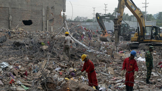 Rescue team members work at the site where a Bangladesh garment-factory building collapsed on April 24 in Savar, near Dhaka, Bangladesh, Monday, May 13, 2013. Nearly three weeks after the building collapsed, the search for the dead ended Monday at the site of the worst disaster in the history of the global garment industry. The death toll: 1,127.(AP Photo/A.M. Ahad)