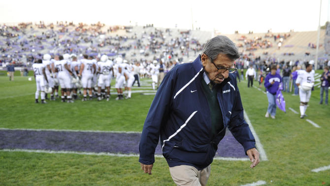 FILE - In this Oct. 22, 2011 file photo, Penn State football coach Joe Paterno walks off the field after warm ups before Penn State's NCAA college football game against Northwestern, in Evanston, Ill. A person familiar with the decision says Paterno has decided to retire at the end of the season. The person says Paterno will announce his retirement later Wednesday, Nov. 9, 2011 . (AP Photo/Jim Prisching, File)