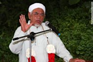 Hadi sticks to hudud stand, unfazed by Karpals view