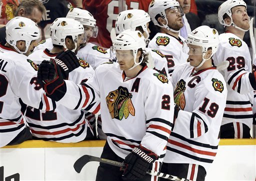 Chicago Blackhawks center Jonathan Toews (19) and Duncan Keith (2) celebrate after Toews scored against the Nashville Predators in the second period of an NHL hockey game, Sunday, Feb. 10, 2013, in Nashville, Tenn. (AP Photo/Mark Humphrey)