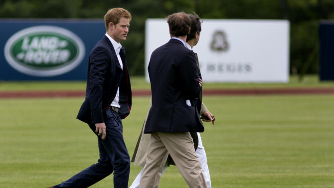 Britain's Prince Harry walks across the polo field before the Sentebale Royal Salute Polo Cup charity match in Greenwich, Conn., Wednesday, May 15, 2013.  Prince Harry is  is competing at the Greenwich Polo Club to benefit Sentebale, the charity he co-founded to help poor children and AIDS orphans in the small African nation of Lesotho.  (AP Photo/Craig Ruttle)