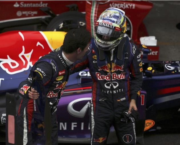 Sebastian Vettel of Germany greets Mark Webber of Australia after the Brazilian F1 Grand Prix at the Interlagos circuit in Sao Paulo