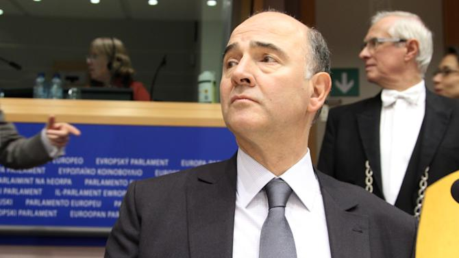 French Finance Minister Pierre Moscovici looks up, during a hearing of the Committee on Economic and Monetary Affairs, at the European Parliament in Brussels, Monday, Dec. 3, 2012. Details of a plan for Greece to reduce its heavy debt by buying some of it back at bargain prices will be presented Monday to finance ministers from the 17 European Union countries that use the euro. (AP Photo/Yves Logghe)