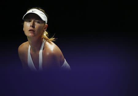 Maria Sharapova of Russia waits for a serve from Petra Kvitova of the Czech Republic during their WTA Finals singles tennis match at the Singapore Indoor Stadium