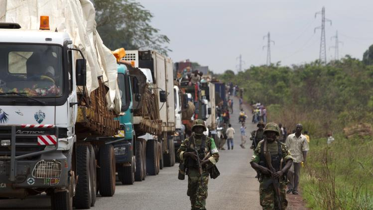 African Union peacekeepers guard a commercial convoy making its way to the border of Cameroon, near Bangui