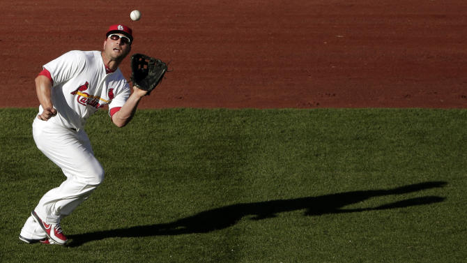 St. Louis Cardinals left fielder Matt Holliday catches a fly ball for the out on Washington Nationals' Jayson Werth during the second inning of Game 2 of the National League division baseball series, Monday, Oct. 8, 2012, in St. Louis. (AP Photo/Charlie Riedel)