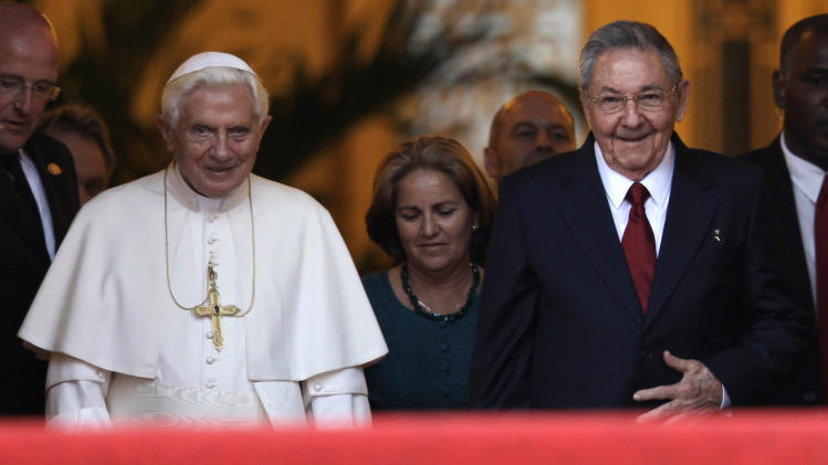 Pope Benedict XVI, left, and Cuban President Raul Castro walk outside the Revolution palace at the end of their meeting in Havana, Tuesday, March 27, 2012. The meeting took place behind closed doors on the pontiff's second day on the island.(AP Photo/Javier Galeano)