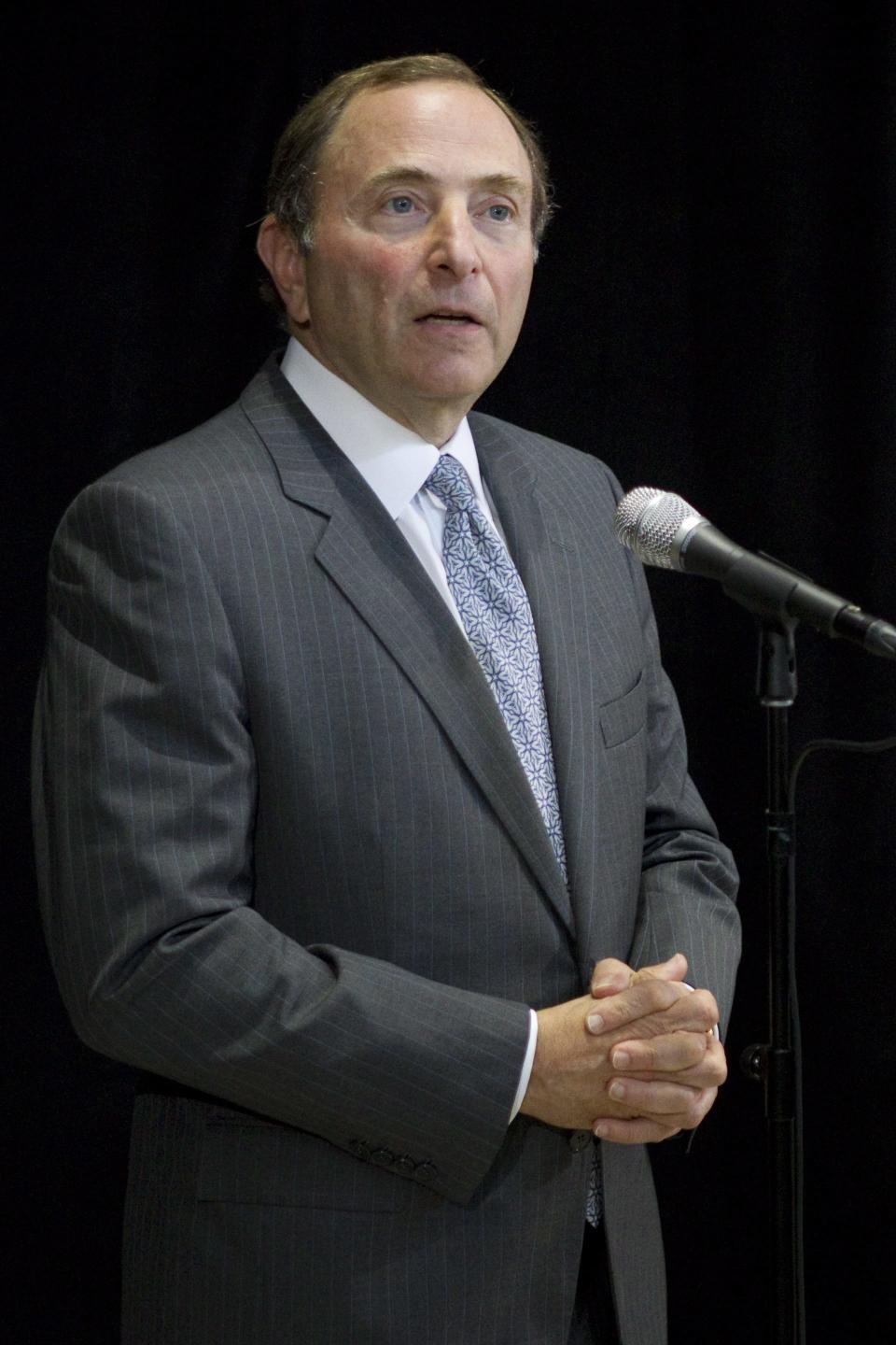 NHL Commissioner Gary Bettman speaks to reporters following collective bargaining talks with the NHL Players' Association, Tuesday, Aug. 14, 2012, in Toronto. (AP Photo/The Canadian Press, Chris Young)