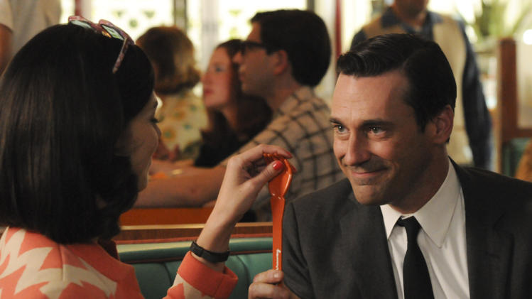 Megan Draper (Jessica Pare) and Don Draper (Jon Hamm)